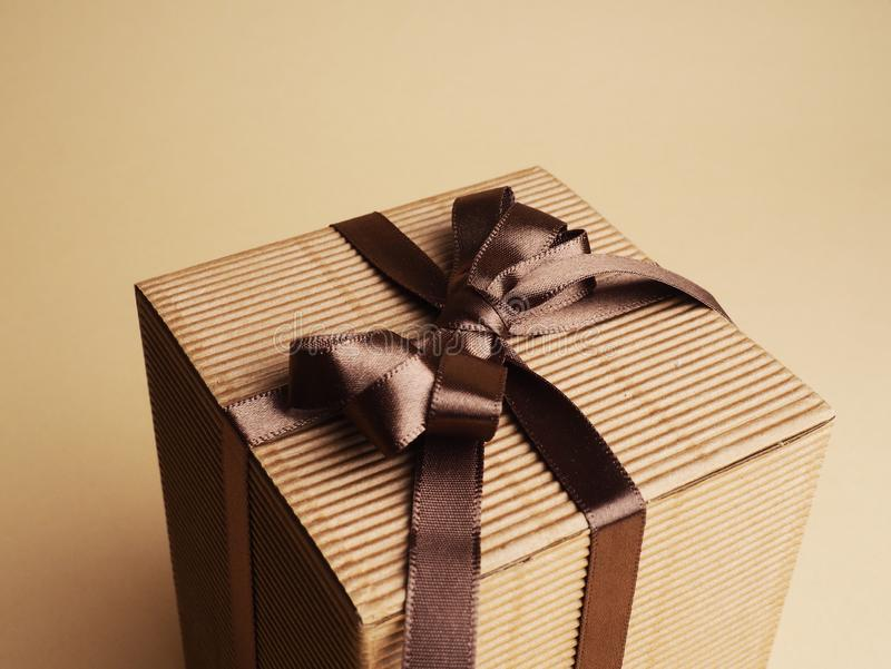Group of gift boxes wrapped with kraft paper and brown satin ribbon . Modern presents for any holiday, christmas, valentine or royalty free stock images