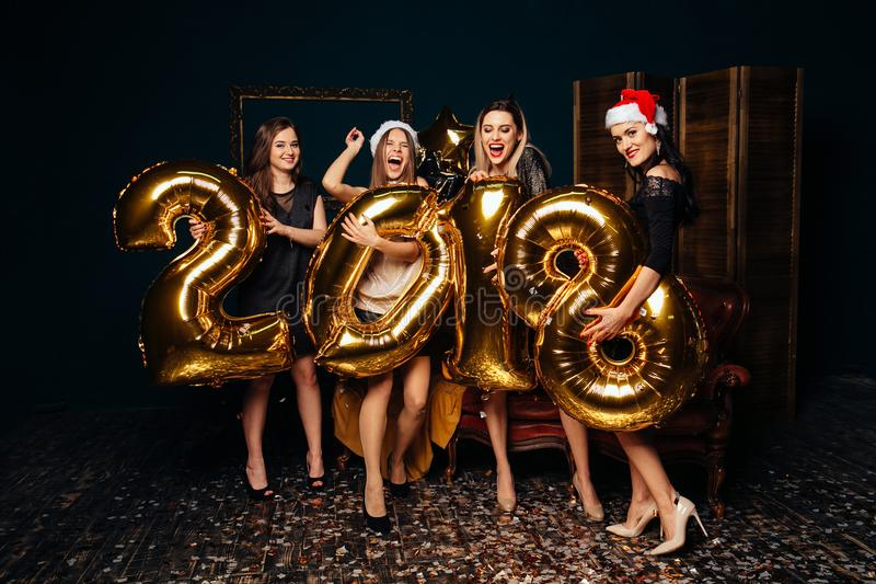 Group of girlfriends celebrating New year royalty free stock photo