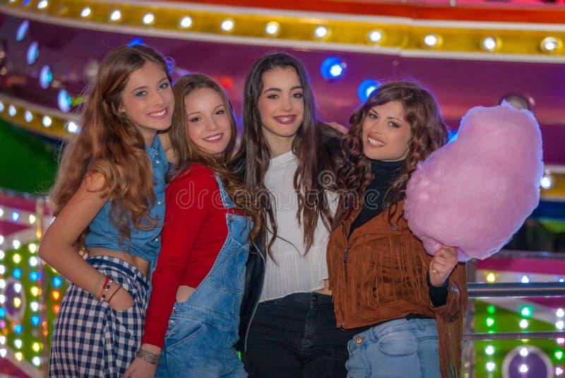 Group of girls at carnival fair. royalty free stock image