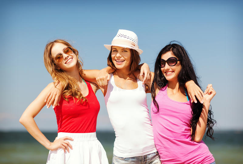 Group of girls chilling on the beach royalty free stock photos