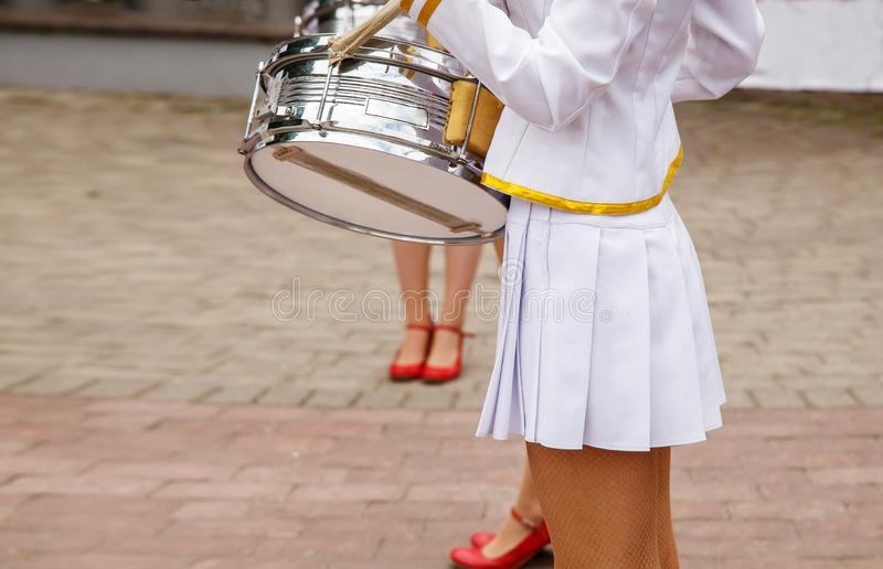 Group of girls drummers. Parade on a city street. body parts closeup royalty free stock photos