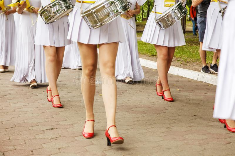 Group of girls drummers. Parade on a city street. body parts closeup stock photo