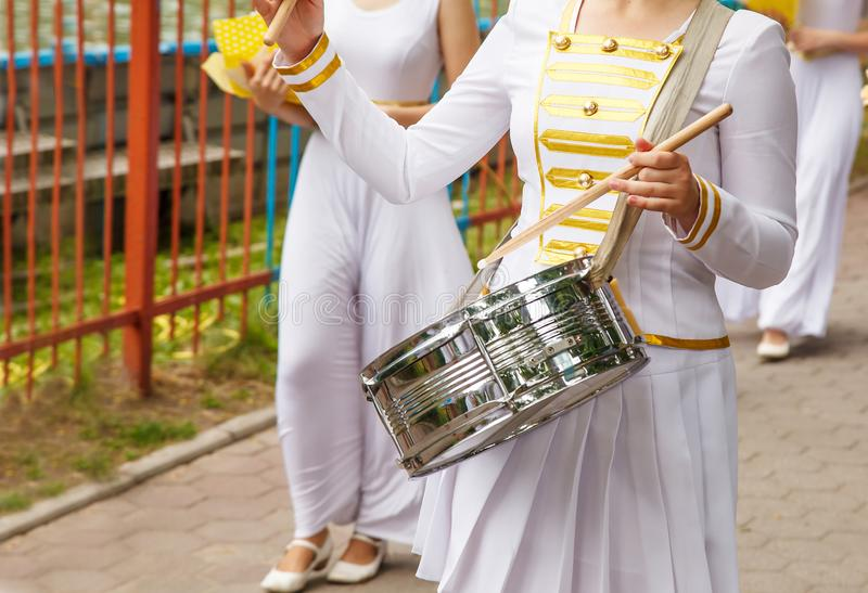 Group of girls drummers. Parade on a city street. body parts closeup royalty free stock photo