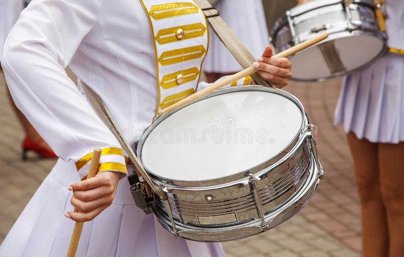 Group of girls drummers. Parade on a city street. body parts closeup royalty free stock photography