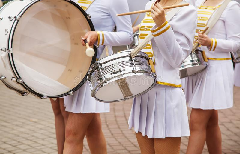 Group of girls drummers. Parade on a city street. body parts closeup stock photos