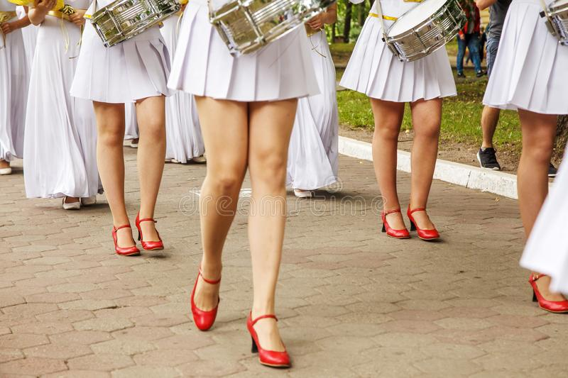 Group of girls drummers. Parade on a city street. body parts closeup royalty free stock image