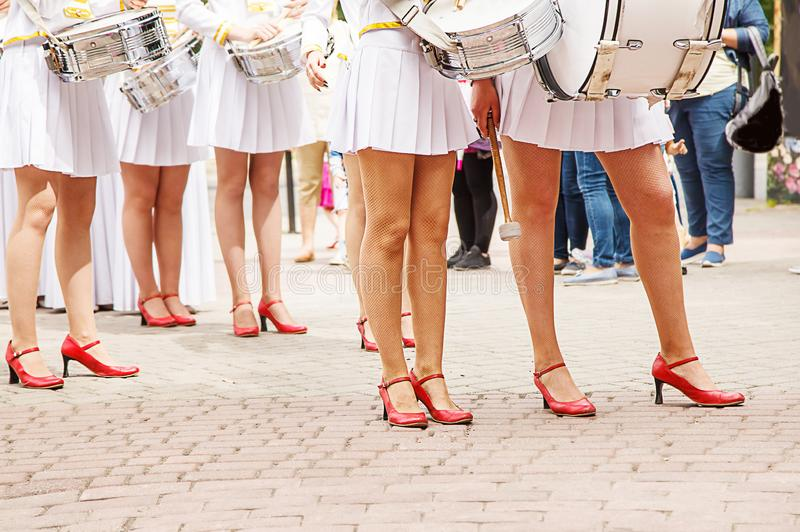 Group of girls drummers. Parade on a city street. body parts closeup stock photography