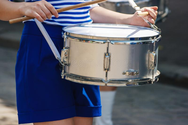 Group of girls drummers. parade on a city street. Body parts closeup stock images