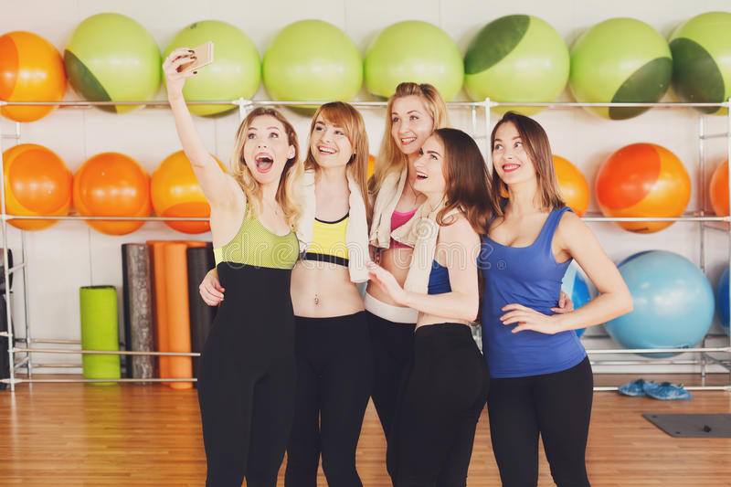 Group of girls in fitness class making selfi royalty free stock image