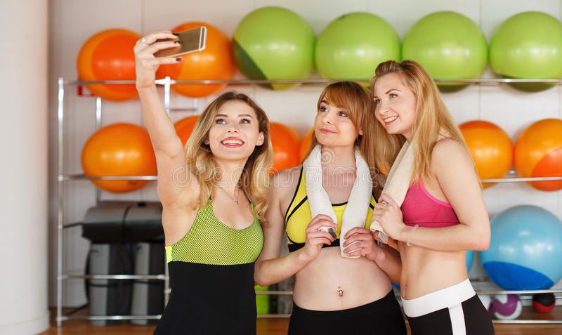 Group of girls in fitness class making selfi stock photography