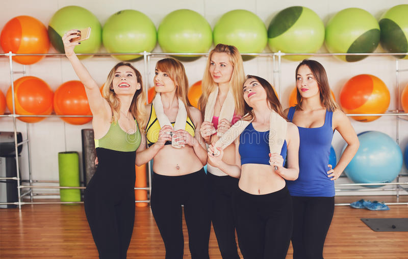 Group of girls in fitness class making selfi stock photo