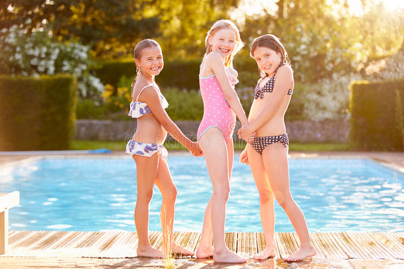 Group Of Girls Playing In Outdoor Swimming Pool stock images