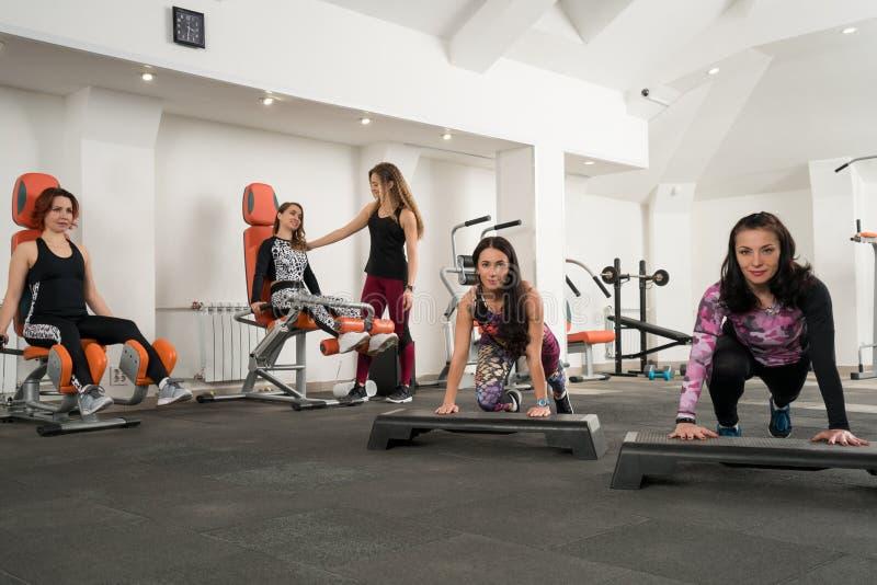 Young women training in a gym shot stock photo
