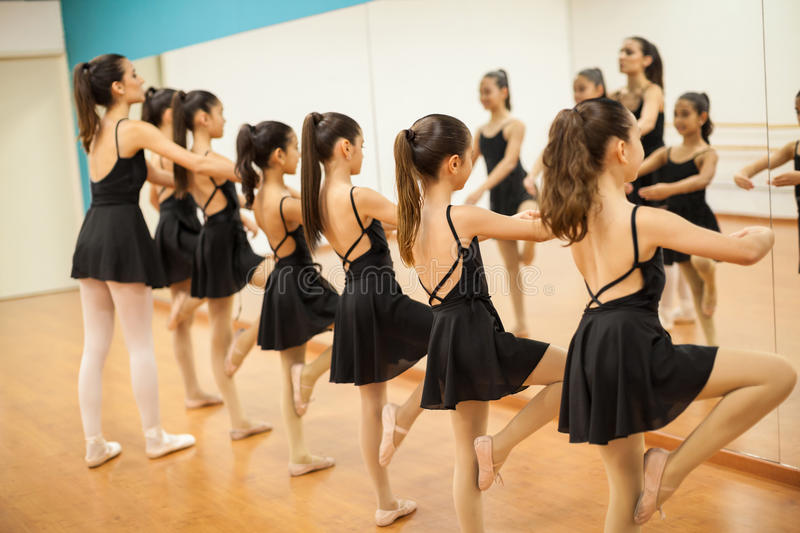 Group of girls and teacher in a dance academy royalty free stock images