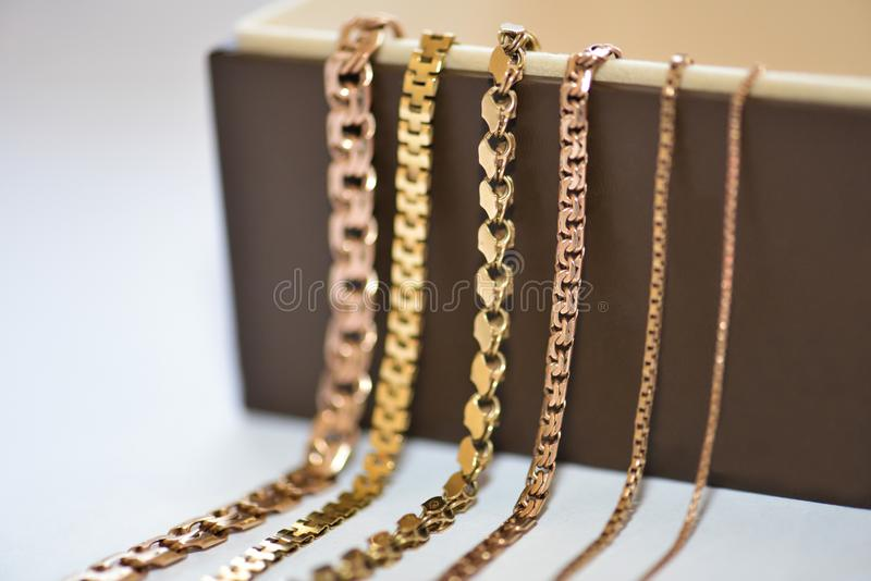Group of gold chains on white background royalty free stock photo