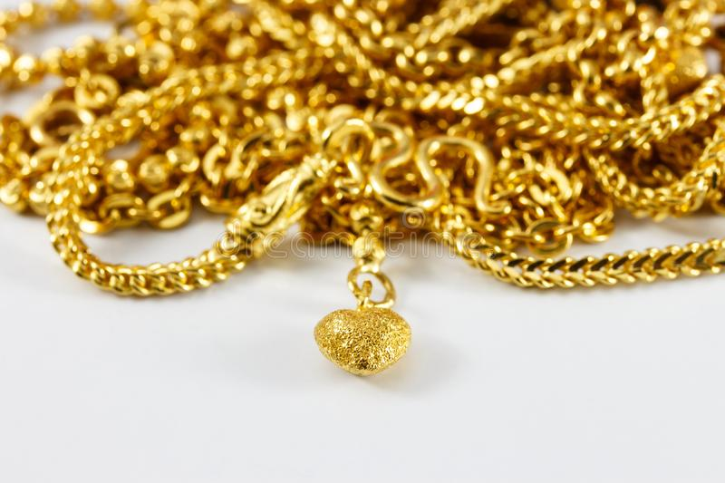 Group of gold necklace and gold bracelet stock photography