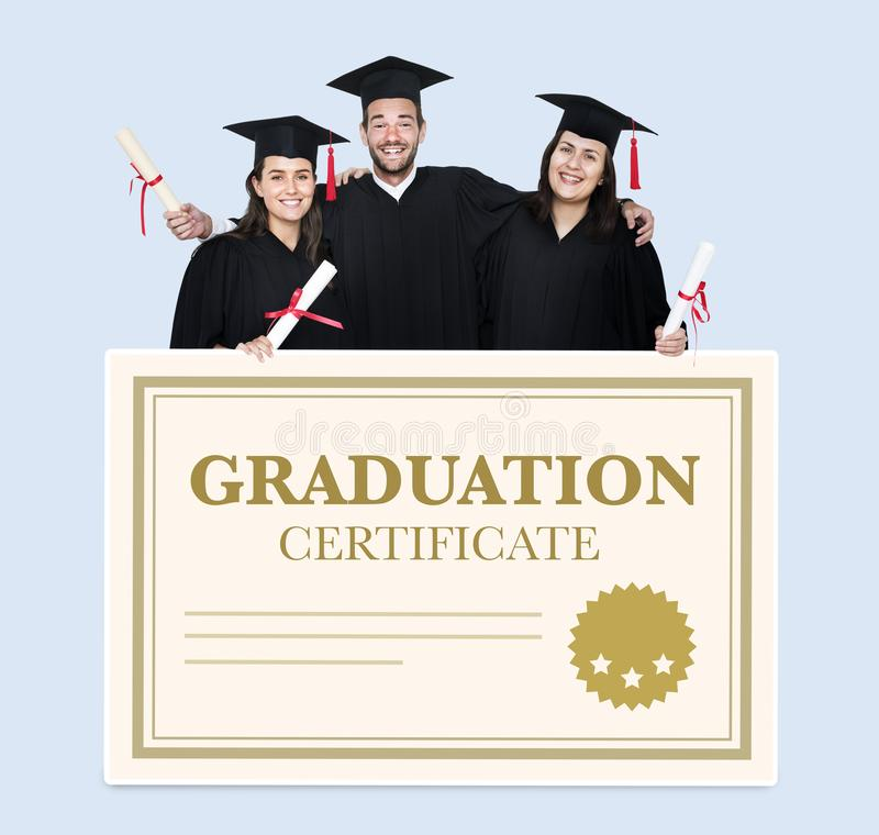 Group of grads in cap and gown with graduation certificate stock photos