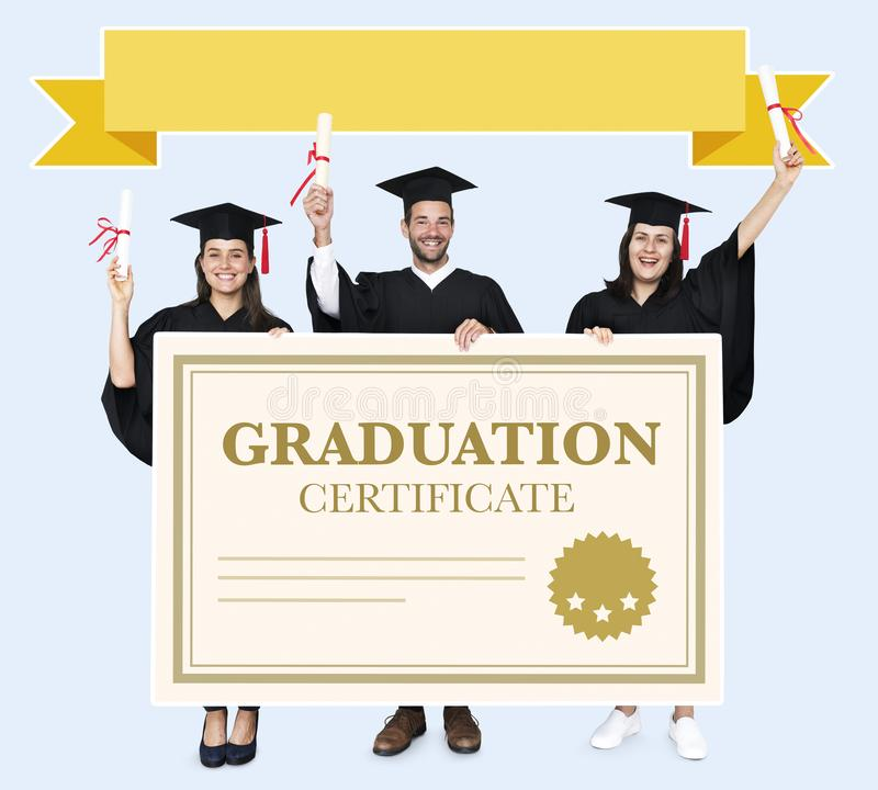 Group of grads in cap and gown with graduation certificate stock photography
