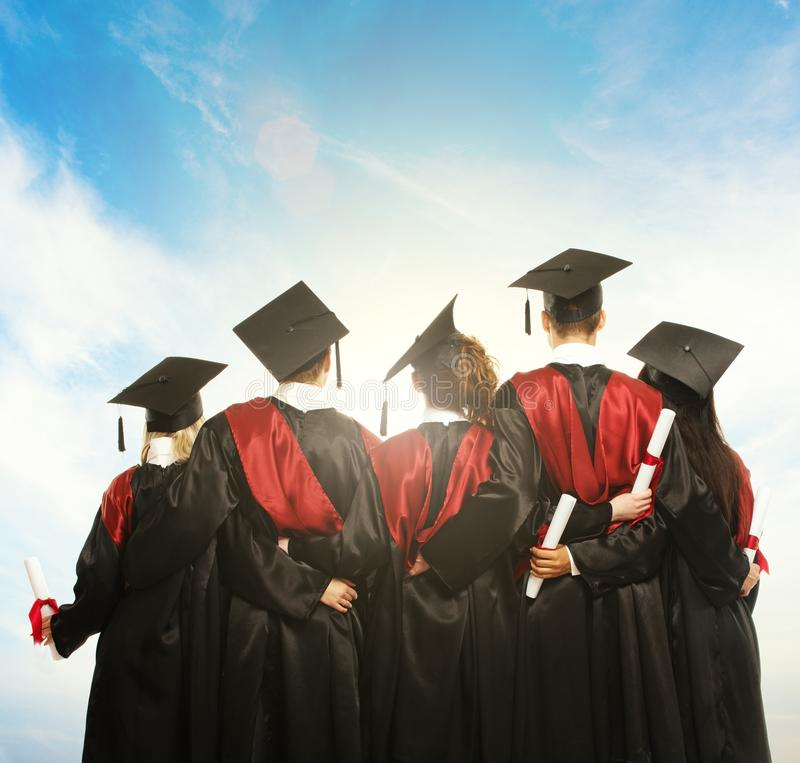 Group of graduated young students stock photography
