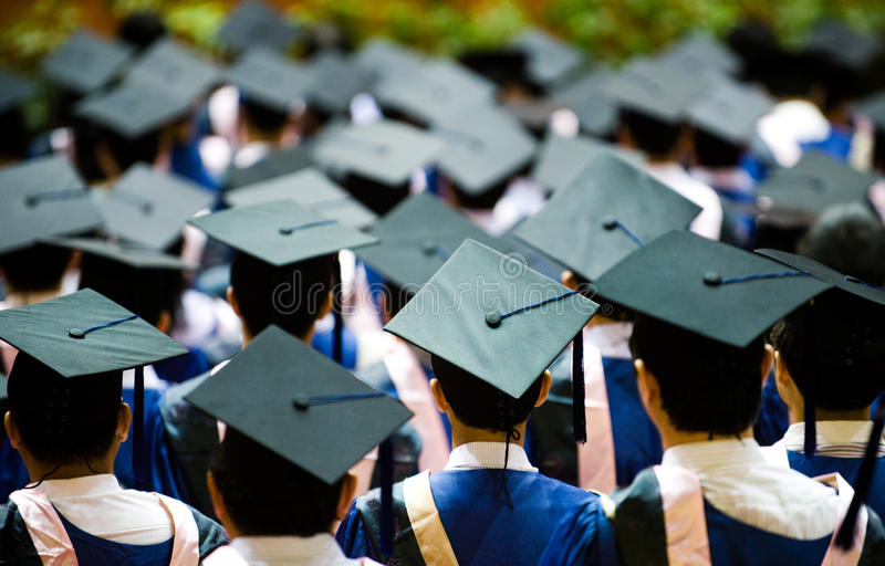 Group of graduates stock photos