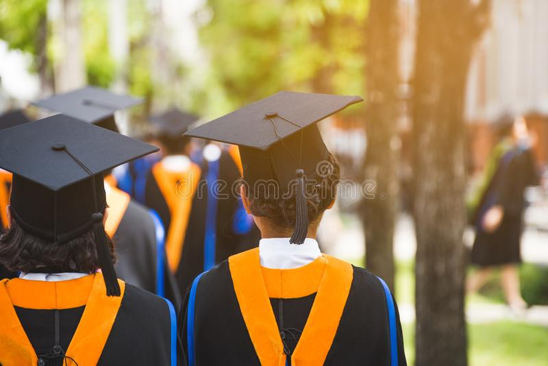 Group of  Graduates during commencement. Concept education congratulation in University. Rear view Group of  Graduates during commencement. Concept education stock image