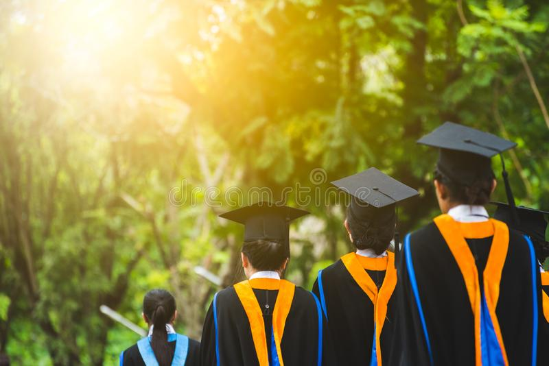 Group of  Graduates during commencement. Concept education congratulation in University. Rear view Group of  Graduates during commencement. Concept education royalty free stock images
