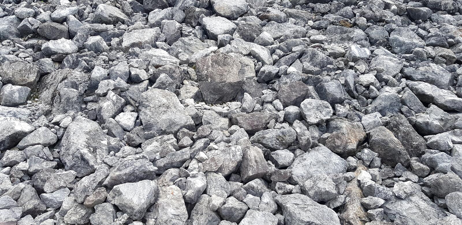 Group of gray stone or rock on ground for background or wallpaper royalty free stock images