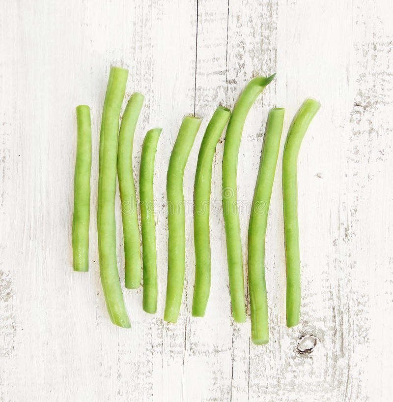 Group green beans on the shabby background royalty free stock images