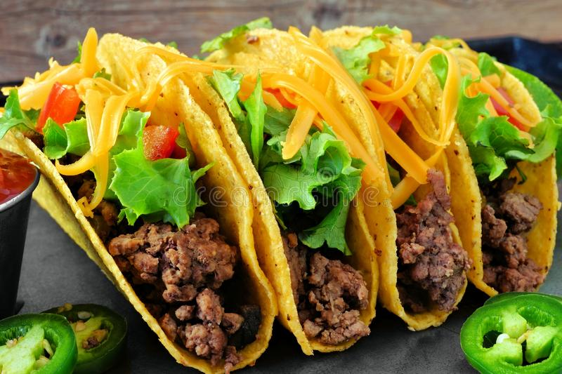 Group of ground beef hard shelled tacos close up stock photos