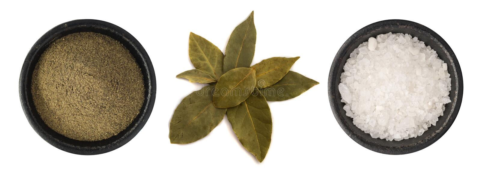 Group of Ground Black Pepper, Salt and Bay Leaves Isolated. On White Background Top View stock photography