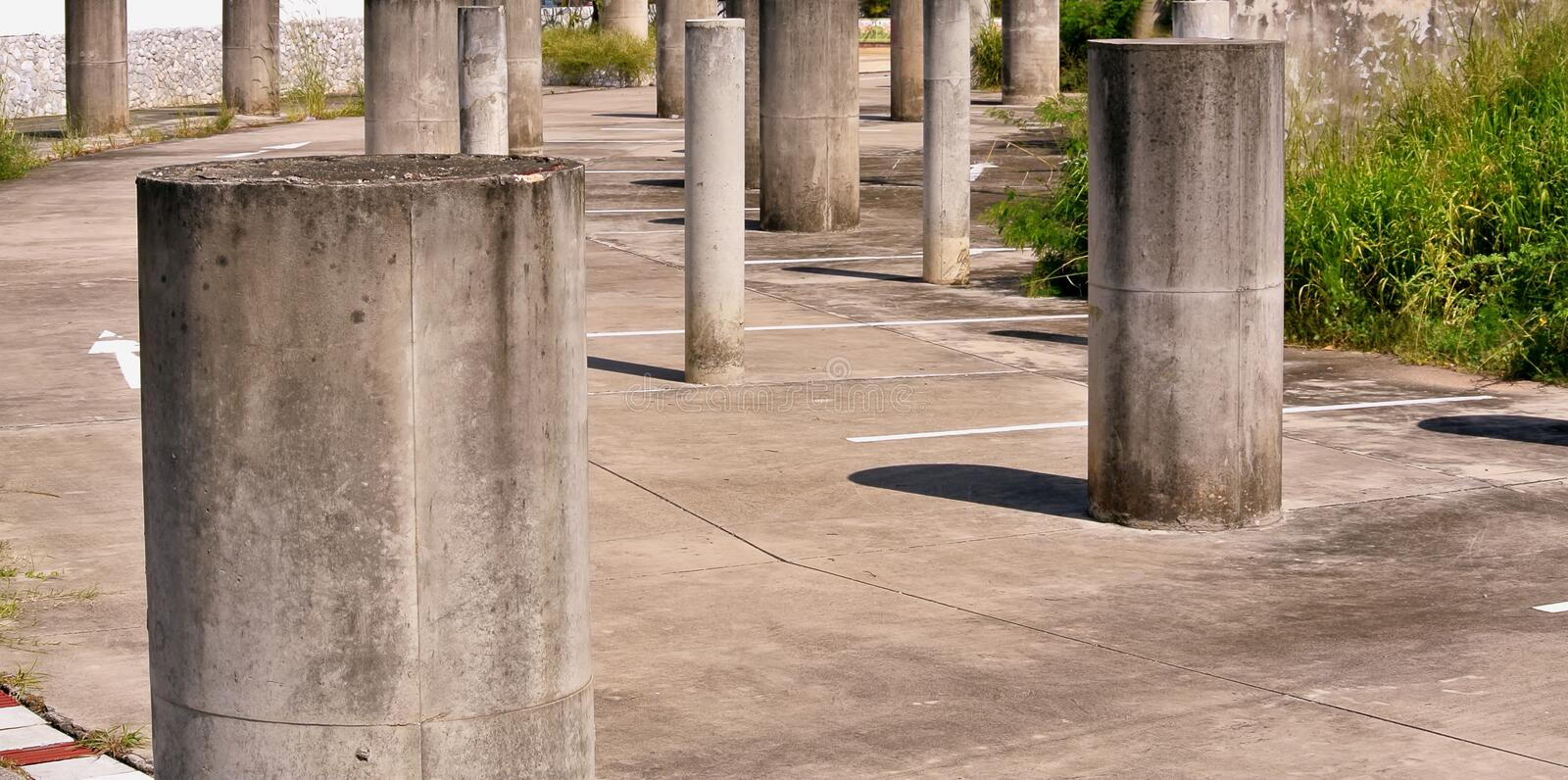 Group of Concrete Pillars at Abandoned Parking Lot. Group of Grungy Concrete Pillars at Abandoned Parking Lot stock photos