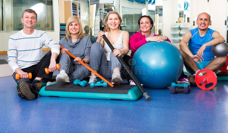 Group in gym with sport equipment royalty free stock images