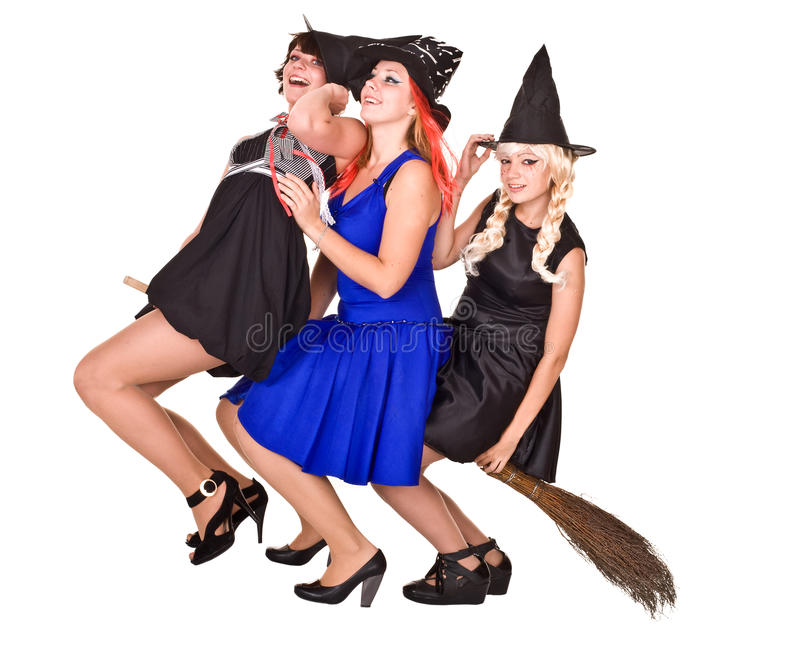 Group Halloween witch in costume fly on broom. Group Halloween witch in black dress and hat fly on broom.Isolated stock images