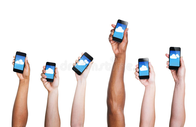 Group of Hand Holding Digital Devices with Cloud Symbol.  royalty free stock photos