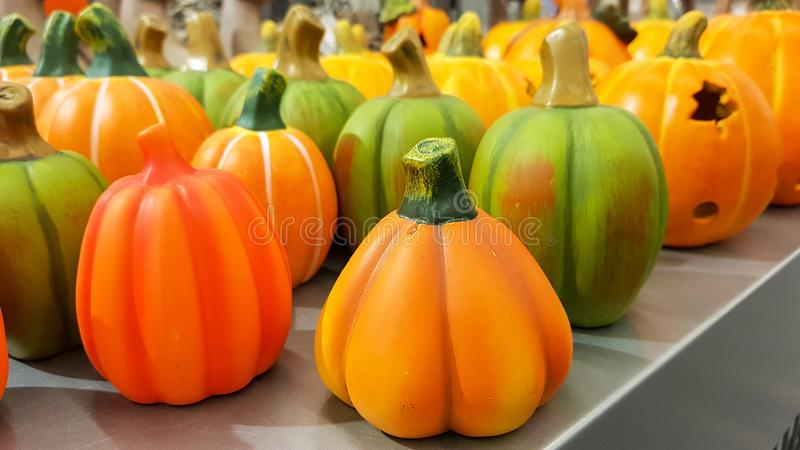 Group of hand painted colorful decoration clay pumpkins for Halloween stock photo