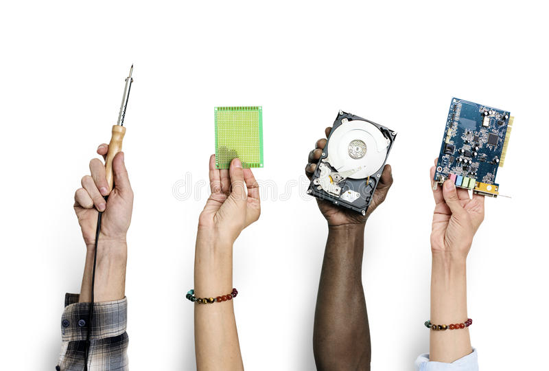 Group of hands holding computer electronics parts isolated on white royalty free stock image