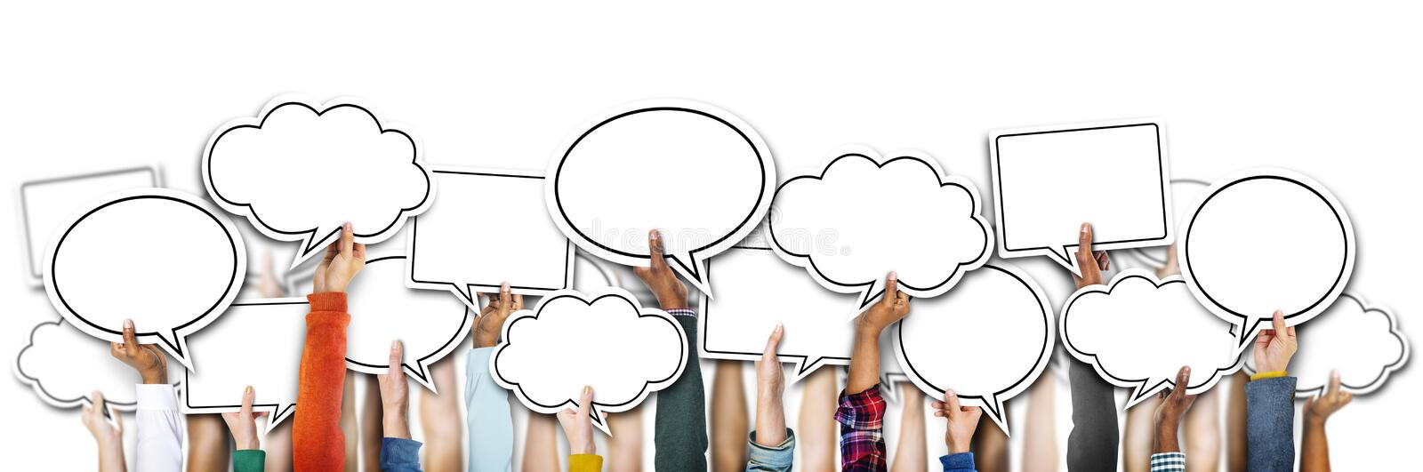 Group of Hands Holding Speech Bubbles royalty free stock image