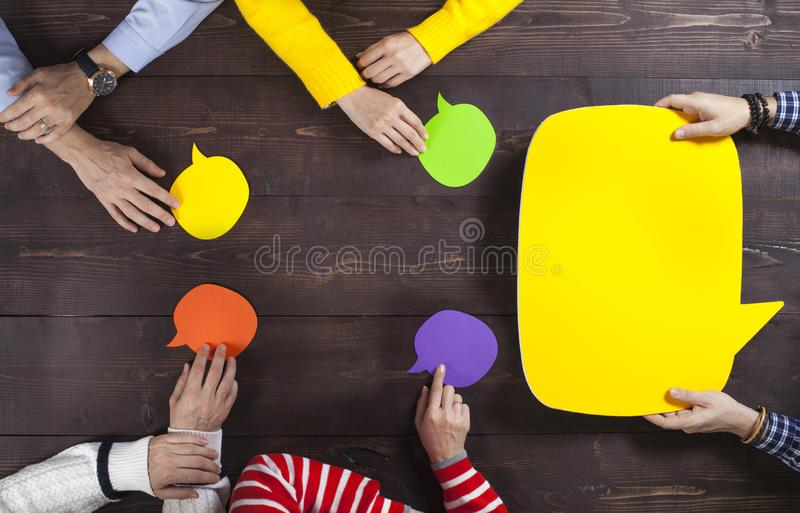 Business team and speech bubbles royalty free stock photo