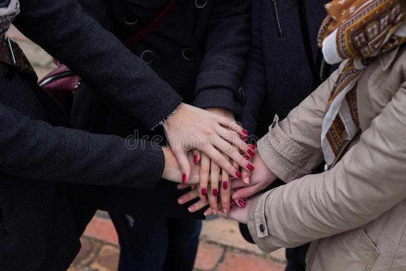 Group with hands together, friendship royalty free stock image