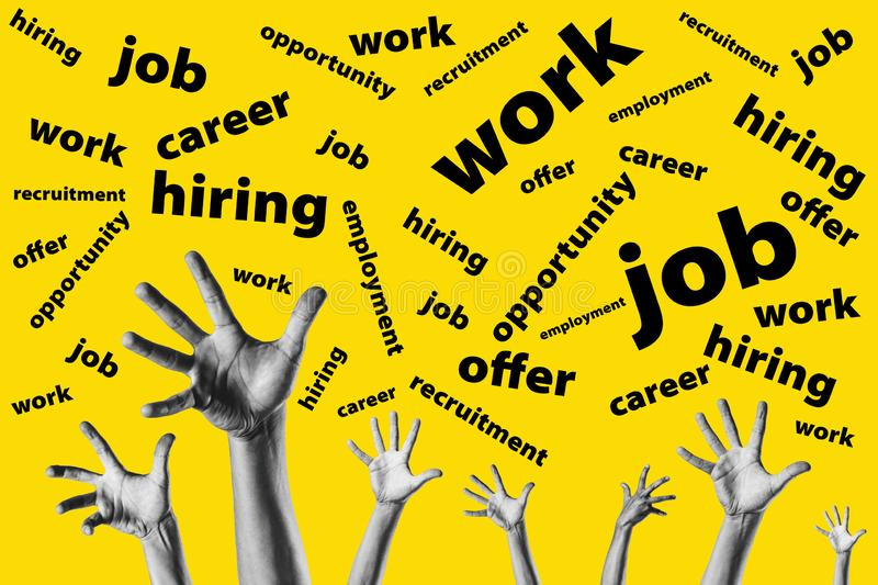 group hands trying to reach job offers over a yellow background - looking for work - job opportunity stock photos