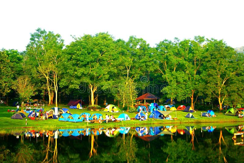 Group of happiness people camping tent with small forest and the lake. At Jetkod-Pongkonsao natural study and eco-tourism center, Saraburi, Thailand stock photo