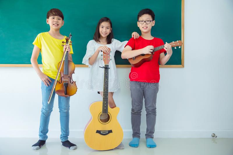 Group of kids with Music Instruments and smile royalty free stock image