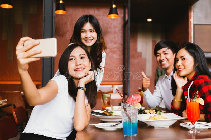 Group of Happy Asian male and female friends taking a selfie photo royalty free stock photos