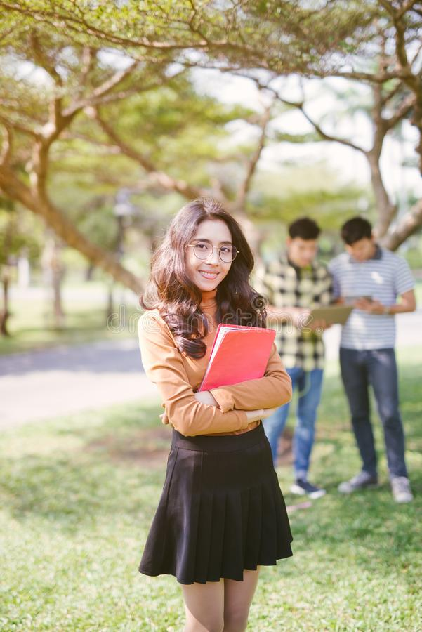 Group of happy asian teenage students with school folders royalty free stock photos