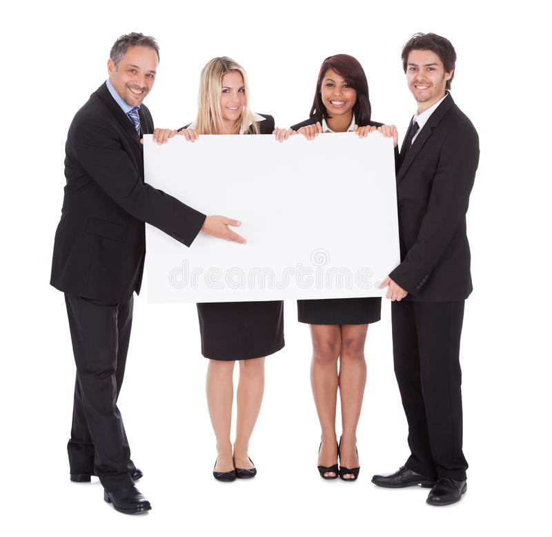 Group of happy business colleagues. Holding billboard isolated on white background stock images