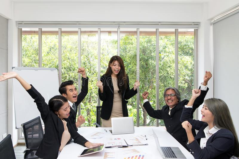 Group of happy business people cheering in office. Celebrate success. Business team celebrate a good job in the office. Asian royalty free stock photography