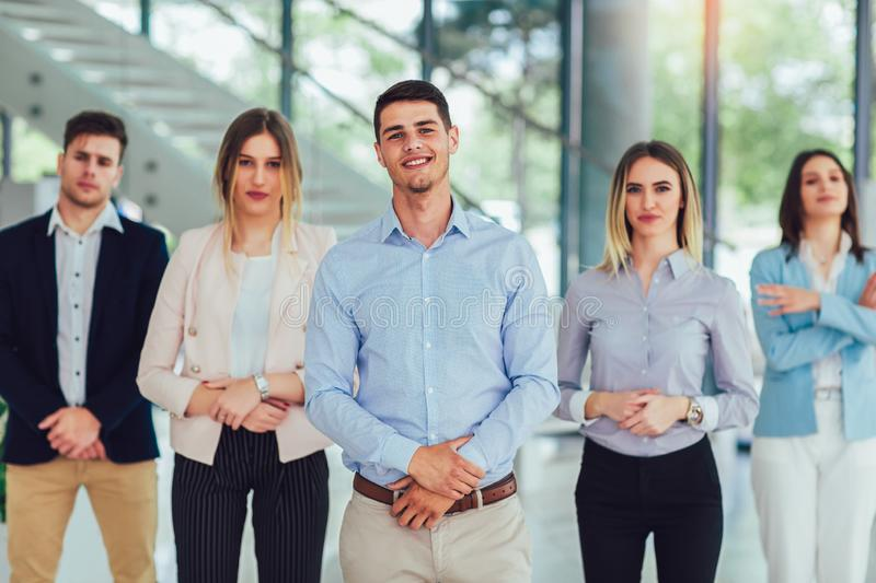 Happy business people and company staff in modern office, representing company royalty free stock images