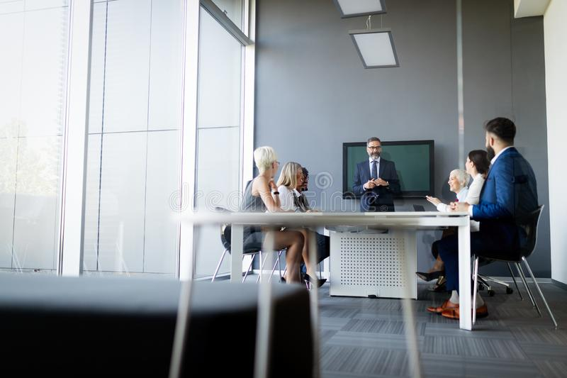 Group of happy business people working in a meeting at office stock image