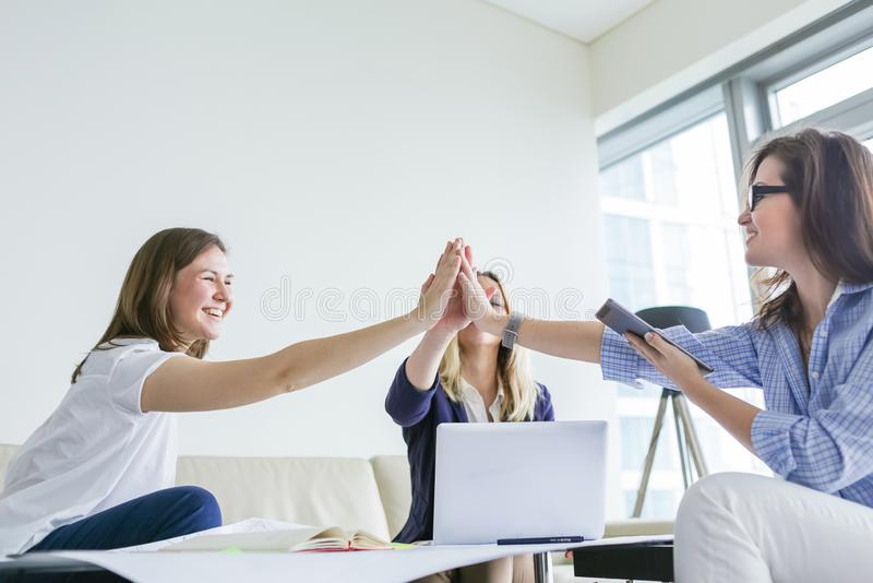 Group of happy business women celebrate the success of a project stock image