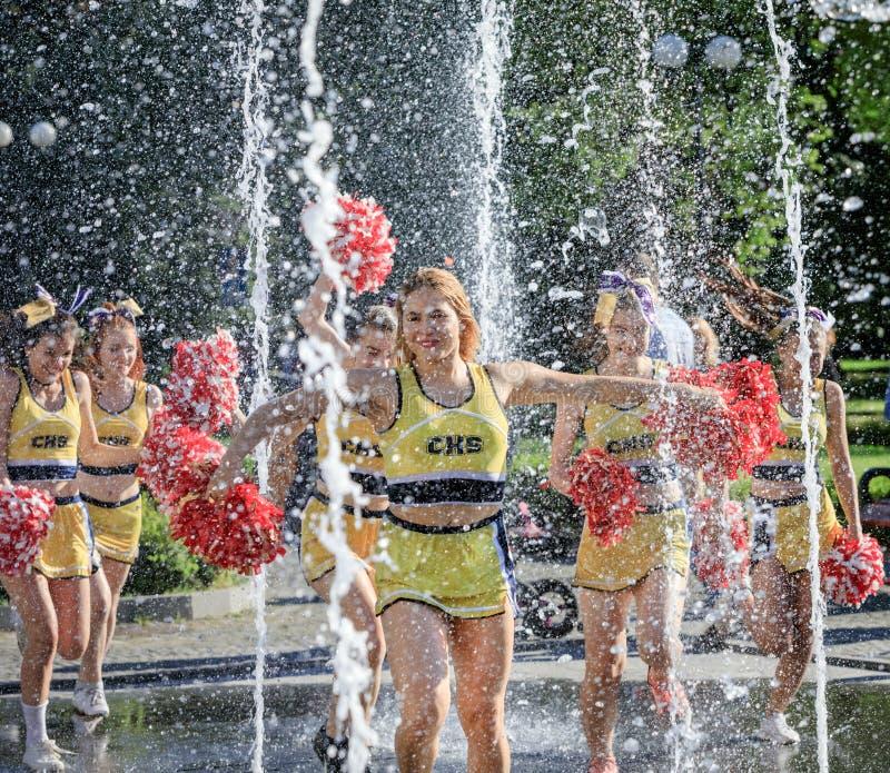 Group Of Happy Cheerleaders Enjoy Jogging Through The